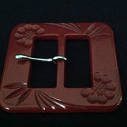 Vintage deeply carved brick red bakelite belt buckle