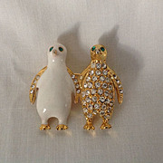 Charming twin gold tone penguins in glittering rhinestones and white enamel