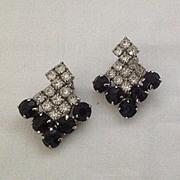 Black and clear rhinestone shield clip earrings.