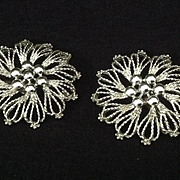Emmons large stylized floral earrings in white metal