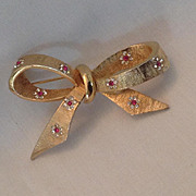 BSK bow pin with dainty rhinestone flowers