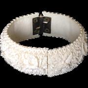 Deeply carved white celluloid clamper bracelet