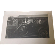 Real Photo Postcard of Man, Woman and Dog in Automobile with Sad message on the ...