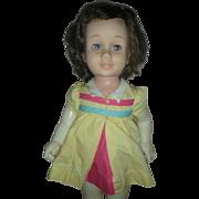 Vintage Brunette Mattel Chatty Cathy Doll wearing Nursery School Dress