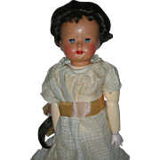 Vintage French Jumeau Celluloid Doll wearing original Dress replaced wig