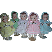 Set of 5 Dionne Quintuplet all Bisque Dolls with Pins Wearing Dotted Swiss Dresses