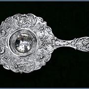 Large Ornate Antique German Silver Tea Strainer: Pan, Figural