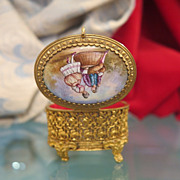 Oval Ormolu gilt jewelry casket with painted enamel lid, late 19th century