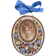 Oval shaped Micro Mosaic frame depicting colourful  flowers, 19th century