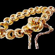 Antique Victorian 14K YG baby bracelet with diamond love knot