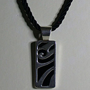Sterling Silver & Black Onyx Pendant On Cord by Carolyn Pollack