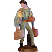 Continental French Art Deco Porcelain Figure of a Traveling Salesman Carrying Suitcases and ..