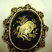 Large Black Glass Broach with Gold PaintedTransfer Ram
