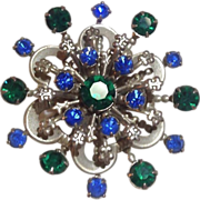 Round Silver-Tone Stacked Broach with Green and Blue Prong-Set Rhinestones