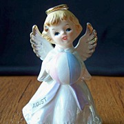 August Angel Holding A Beach Ball Figurine
