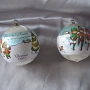 Two 1980 Joan Walsh Anglund Christmas Satin Ball Ornaments