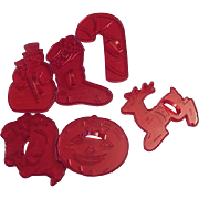 Six HRM Red Plastic Cookie Cutters