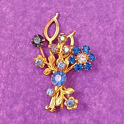 Sparkling Figural Flower Pin of Blue & Aurora Borealis Rhinestones