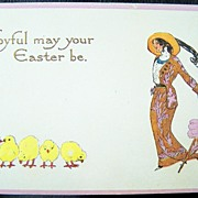1913 Gene Carr Embossed Gilded Postcard, Stylish Edwardian Lady with Parasol Admires Easter Ch