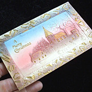1908 Deeply Embossed Airbrushed Gilded Postcard, Christmas Dawns on Stone Church Complex