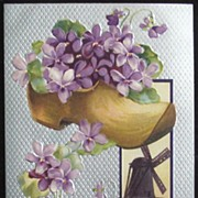 1909 Silvered Litho Postcard, Dutch Clogs Overflowing with Violets, Windmill Inset