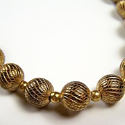 "Gold-Tone Swirl Textured Beaded 24"" Necklace, 1960s-1970s"