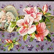 1910 Winsch Embossed Gilded Postcard, Georgian Sweethearts, Pink Hibiscus, Violets & Golden He