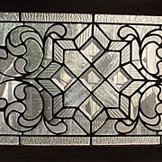 Clear textured and beveled stain glass window