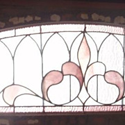 Long stained glass arched transom
