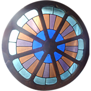 Unusual stained glass wagon wheel window