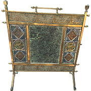 SOLD Aesthetic movement brass fire screen with 6 painted and fired stained glass panels