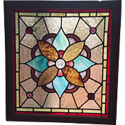 American Victorian  pin wheel stained glass window