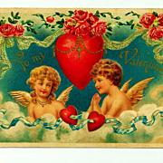 c1909 Cupids Valentine Antique Postcard -  Blonde Girl and Brunette Boy in a Cloud - German-Ma