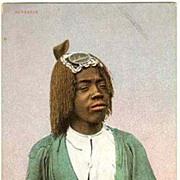 Barbarian: Vintage Postcard of African Lady