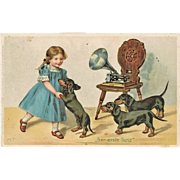 SOLD Girl dancing with Sausage Dog to Music from Gramophone. Vintage Postcard