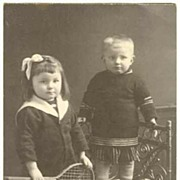 Cute Photo of Girl with Tennis Racket. 1915