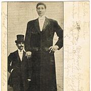 Giant Machnow, tallest Man in World. Vintage postcard 1903