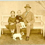 Lovely old photo of a father with 2 children and baby dog. ca. 1910