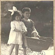 Girl and Boy with their Doll in a Pram. Photographer signed Studio Photo