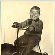 appr 1940: Happy boy on his tricycle. Vintage Photograph