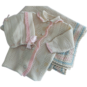 Vintage nursery baby girl or doll knitted wool pink cream and blue sweater bonnet and blanket