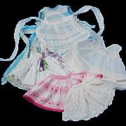 Group vintage 1950's doll dresses pinafore slip skirt