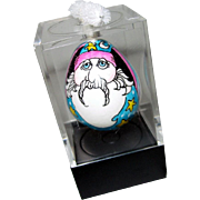 Miniature hand painted egg with wizard face, signed, circa 1991