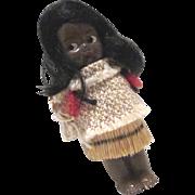 Small hard plastic frozen charlotte doll Hawaiian