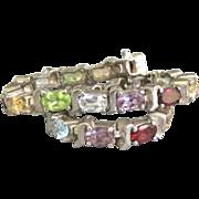 Lovely Sterling Gemstone Bracelet with Blue Topaz, Peridot, Amethyst, Citrine and Garnet