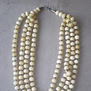 Wonderful Four Strand Bone Bead Necklace