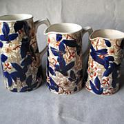 Three Graduated Antique Staffordshire Imari Pitchers