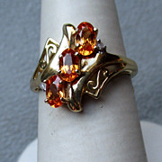 10k Gold and Spessartite Garnet Ring with Diamond Accents