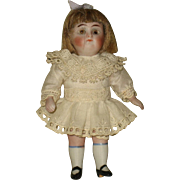 SOLD German 4 1/4 inch all bisque with brown sleep eyes