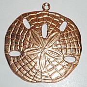 Copper Toned Sand Dollar Pendant